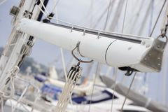 Boom with pulley. Boom with three ropes pulley. Yacht anchored in harbor Royalty Free Stock Photography