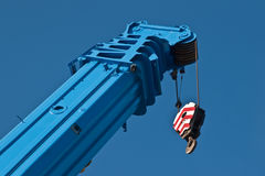 Boom truck crane. Raised boom 250 ton truck crane against the sky Royalty Free Stock Photos