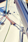 Boom vang is line or piston system on sailboat Stock Photos