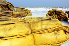 Boom on white sand beach for oil cleanup Royalty Free Stock Photo