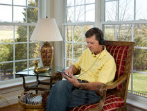 Boomer reading on tablet computer Royalty Free Stock Photos