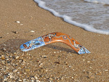 Boomerang. Colorful boomerang on a sandy beach Stock Image