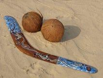 Boomerang and coconuts. Stock Image