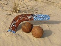 Boomerang and coconuts. Royalty Free Stock Photo