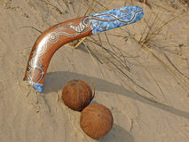 Boomerang and coconuts. Royalty Free Stock Photos