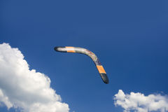 Boomerang in flight. Authentic australian carved and painted boomerang in flight Royalty Free Stock Photo