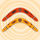 Boomerangs vector illustration. Boomerangs isolated on beige background with circles. Tribal style. Australian style. Vector illustration Stock Photos