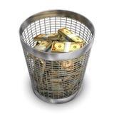 Boondoggle. A full wastebasket with dollars. White background Stock Photo