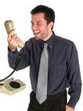 Boos bij de telefoon Stock Foto