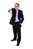 Boos zakenmanportret met neer duim Stock Afbeeldingen