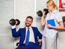 Boost business team. Boost your skill. Man and woman raise heavy dumbbells. Boost sales with strong strategy. Good job royalty free stock photography