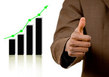 Boost in Profits!. This is an image of a businessman's hand giving thumbs up, due to the rise on the graph Royalty Free Stock Photo