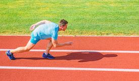 Boost speed concept. Man athlete runner push off starting position stadium path sunny day. Runner sprint race at stadium. Runner captured in motion just after stock images