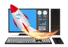 Boost speed desktop computer with toy rocket Royalty Free Stock Image