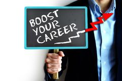 Boost your career concept with businessman holding small blackboard with arrow upward Stock Photo