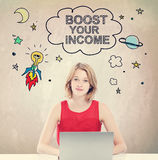 Boost Your Income concept with woman working on laptop Royalty Free Stock Image
