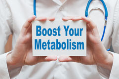 Boost Your Metabolism. Card with text in doctor hands Royalty Free Stock Photos
