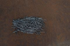 A pile of nails on a sheet of iron. royalty free stock images