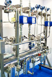 Booster system with meters, pipes and filters. On stand Stock Image