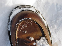 Boot. Snowy leather boot for cold conditions Stock Photography