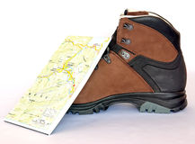 Boot. Leather boot, for climbing and hiking and a mountain map Stock Image