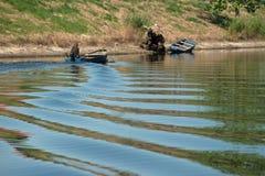 Boot auf einem Fluss Stockfotos