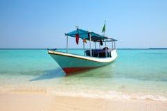 Boot auf einem Strand Stockfoto
