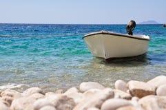 Boot auf einem Strand Stockbilder