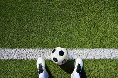 Boot and ball soccer. Shot of a soccer player standing on the field with copy space Stock Image