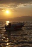 Boot bij zonsondergang Stock Foto's