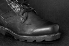 Boot. Black boot set against a black background Stock Image