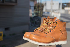 Boot. Brown boot fashion on wall Royalty Free Stock Photography
