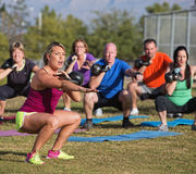 Boot Camp Fitness Trainer Yelling. During squat exercises Stock Photos
