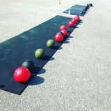 Boot Camp Setup. Exercise boot camp fitness slam balls kettle bells outdoor workout Royalty Free Stock Photography