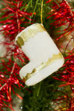Boot on a Christmas tree Royalty Free Stock Image
