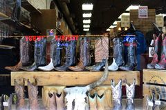 Boot Country. Close up of a shop with cowboy boots and reflection of Tequila Cowboy club on Broadway in Nashville, Tennessee royalty free stock image
