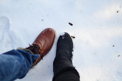 Boot couple on snow together cold Stock Photo