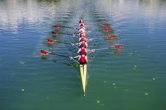 Boot coxed das Rudern mit acht Ruderern Stockbild