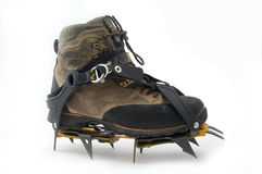 Boot with crampons. Boot with crampons on the white background Royalty Free Stock Photo
