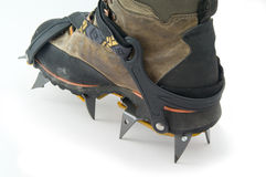 Boot with crampons. Boot with crampons on the white background Royalty Free Stock Photography