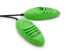 Boot dryer. Green electric boot dryer isolated on white stock photo