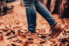 Boot on a path of leaves, autumn stock photo