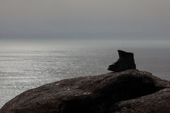 Boot in Finisterre cape, Galicia, Spain. Royalty Free Stock Photo