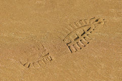 Boot footprint on wet sand Stock Photography