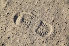 Boot footstep. Single boot footstep inprinted in sand Royalty Free Stock Images