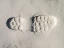 Boot footstep on snow Stock Images
