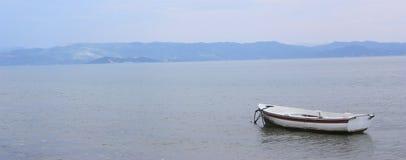 Boot im Meer Stockfotos
