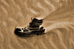 Boot lost in desert Royalty Free Stock Image