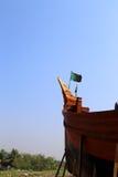 Boot mit Landesflagge Stockfotografie