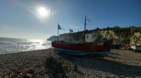 Boot op een strand Stock Foto